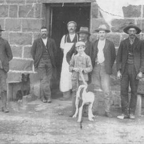 Possibly a photo taken outside the Mouyong Woolshed, but no information on identities of people shown.