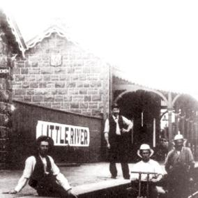 This locally famous photo was taken in 1909. The fellow on the tricycle with white top is Archie Boadle and the guy standing on the platform with the white shirt is Tom McLean (snr). Oth